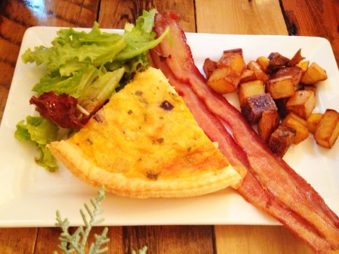 Farmers' Quiche - Made with seasonal vegetables, local eggs, and cheese, served with breakfast potatoes and bacon
